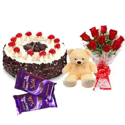 Black Forest Cake with Red Roses bouquet, Teddy Bear & Dairy Milk