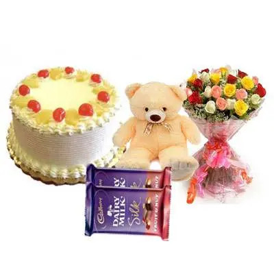 Pineapple Cake with Mix Roses, Teddy Bear & Dairy Milk