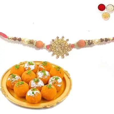 Beautiful Om Rakhi For Brother With Laddu